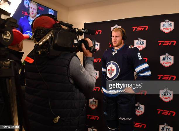 Andrew Copp of the Winnipeg Jets gives an interview during the intermission during the preseason game agains the Edmonton Oilers on September 23 2017...