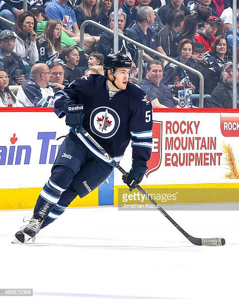 Andrew Copp of the Winnipeg Jets keeps an eye on the play during first period action against the Calgary Flames on April 11 2015 at the MTS Centre in...
