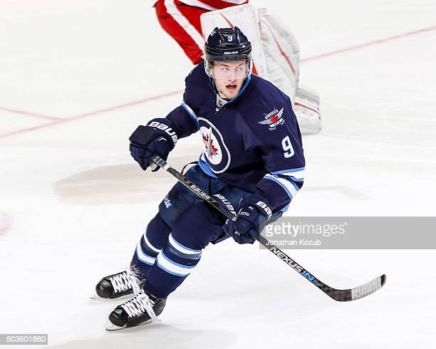 Andrew Copp of the Winnipeg Jets keeps an eye on the play during third period action against the Detroit Red Wings at the MTS Centre on December 29...