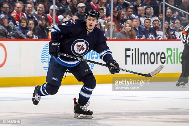 Andrew Copp of the Winnipeg Jets keeps an eye on the play during second period action against the Chicago Blackhawks at the MTS Centre on April 1...