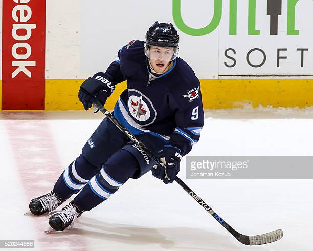 Andrew Copp of the Winnipeg Jets keeps an eye on the play during third period action against the Minnesota Wild at the MTS Centre on April 3 2016 in...