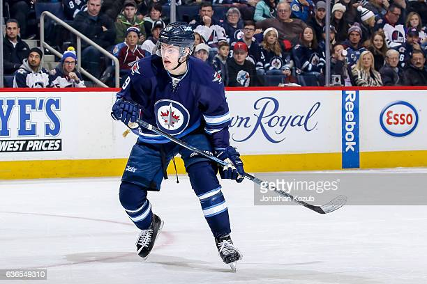 Andrew Copp of the Winnipeg Jets keeps an eye on the play during first period action against the Colorado Avalanche at the MTS Centre on December 18...