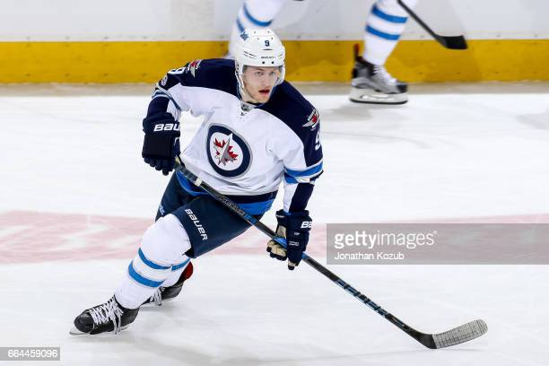 Andrew Copp of the Winnipeg Jets keeps an eye on the play during third period action against the Anaheim Ducks at the MTS Centre on March 30 2017 in...