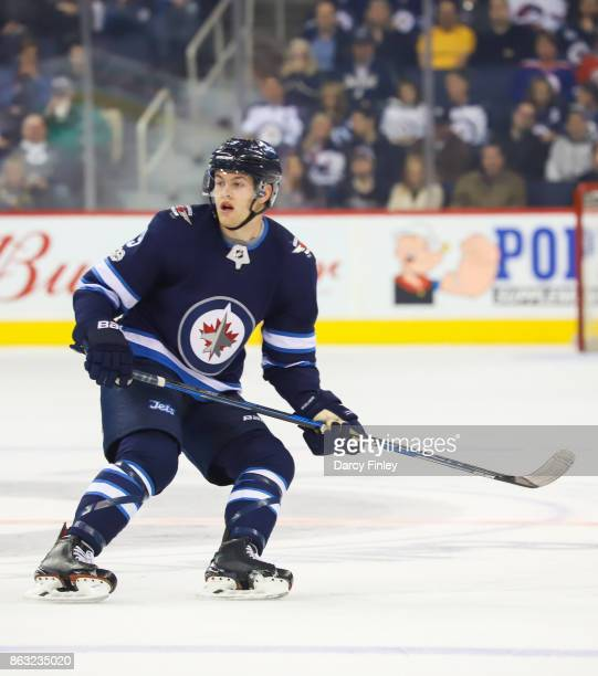 Andrew Copp of the Winnipeg Jets keeps an eye on the play during first period action against the Carolina Hurricanes at the Bell MTS Place on October...