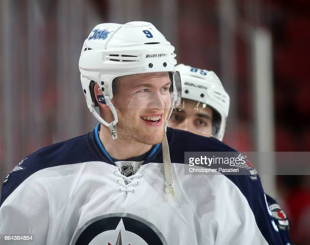 Andrew Copp of the Winnipeg Jets looks on during warm ups prior to the game against the New Jersey Devils on March 28 2017 at the Prudential Center...