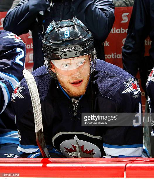 Andrew Copp of the Winnipeg Jets looks on from the bench prior to puck drop against the St Louis Blues at the MTS Centre on January 21 2017 in...