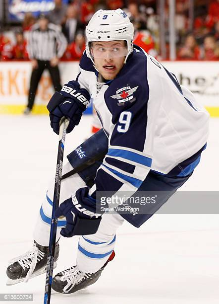 Andrew Copp of the Winnipeg Jets plays in the game against the Chicago Blackhawks at the United Center on December 6 2015 in Chicago Illinois