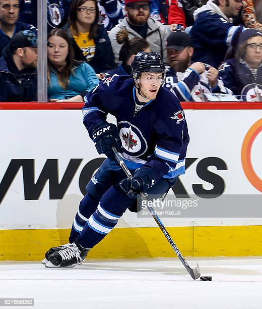 Andrew Copp of the Winnipeg Jets plays the puck down the ice during first period action against the Nashville Predators at the MTS Centre on November...