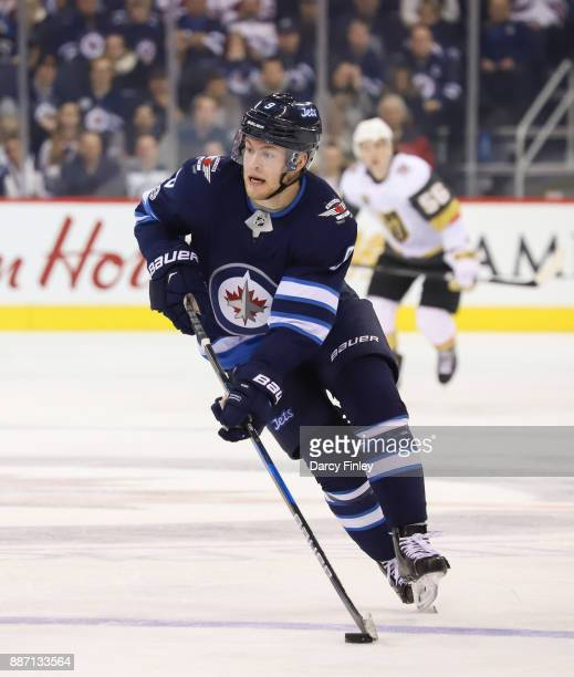 Andrew Copp of the Winnipeg Jets plays the puck down the ice during third period action against the Vegas Golden Knights at the Bell MTS Place on...