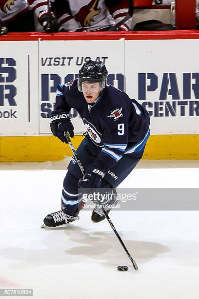 Andrew Copp of the Winnipeg Jets plays the puck up the ice during third period action against the Arizona Coyotes at the MTS Centre on January 26...