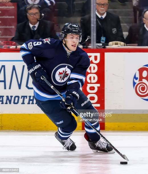 Andrew Copp of the Winnipeg Jets plays the puck up the ice during third period action against the Nashville Predators at the MTS Centre on April 8...