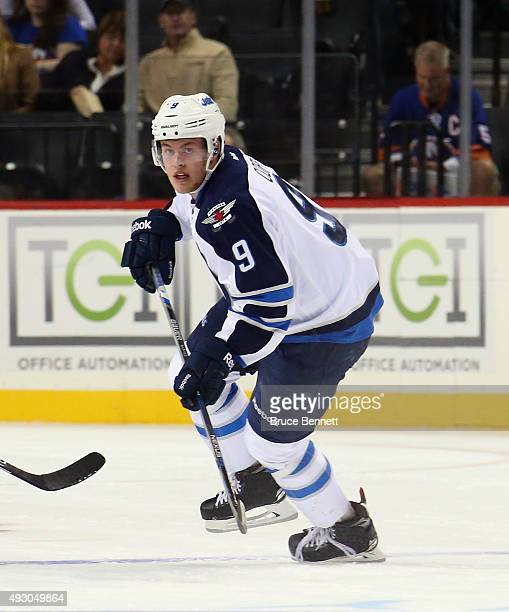 Andrew Copp of the Winnipeg Jets skates against the New York Islanders at the Barclays Center on October 12 2015 in the Brooklyn borough of New York...