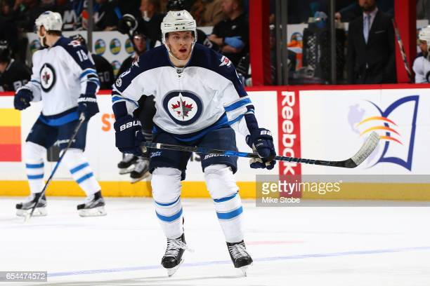 Andrew Copp of the Winnipeg Jets skates against the New York Islanders at the Barclays Center on March 16 2017 in Brooklyn borough of New York City...