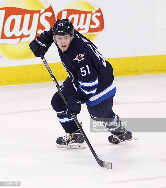Andrew Copp of the Winnipeg Jets skates down the ice during his first NHL game in first period action in a game against the Calgary Flames at the MTS...