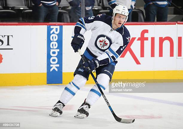 Andrew Copp of the Winnipeg Jets skates during warm ups prior to the game against the Colorado Avalanche at the Pepsi Center on November 28 2015 in...