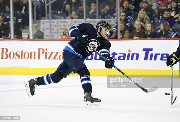 Andrew Copp of the Winnipeg Jets takes a shot on goal during first period action against the St Louis Blues at the MTS Centre on January 21 2017 in...