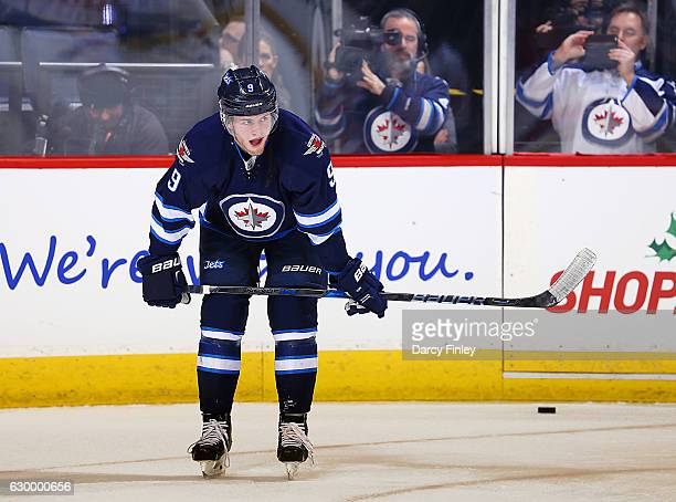 Andrew Copp of the Winnipeg Jets takes part in the pregame warm up prior to NHL action against the Florida Panthers at the MTS Centre on December 15...