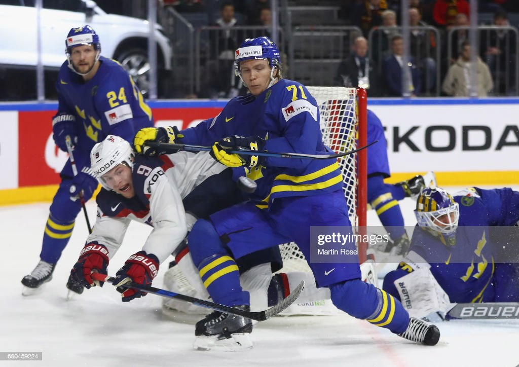 Andrew Copp of USA is challenged by William Karlsson of Sweden during the 2017 IIHF Ice Hockey World Championship game between USA and Sweden at Lanxess Arena on May 8, 2017 in Cologne, Germany.