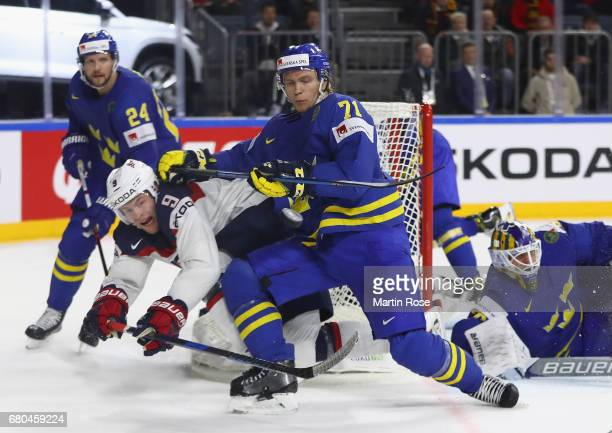 Andrew Copp of USA is challenged by William Karlsson of Sweden during the 2017 IIHF Ice Hockey World Championship game between USA and Sweden at...