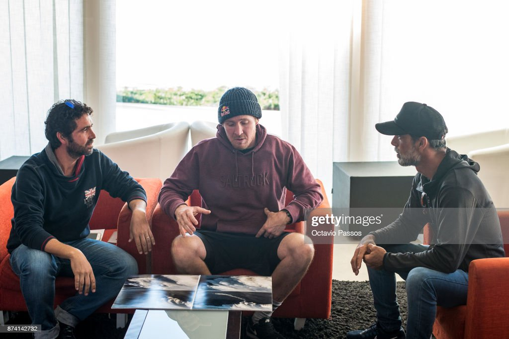 Andrew Cotton (C) and some friends looks for the sequence of images of the wave that he surfed on November 8th at Praia do Norte at Nazare and that suffered the accident, on November 14, 2017 in Nazare, Portugal. Andrew Cotton, 36, from Braunton, Devon in the UK fractured his vertbra L2 after wiping out surfing the giant waves at Nazare Portugal. He was filming a documentary on Wednesday 8th November 2017.