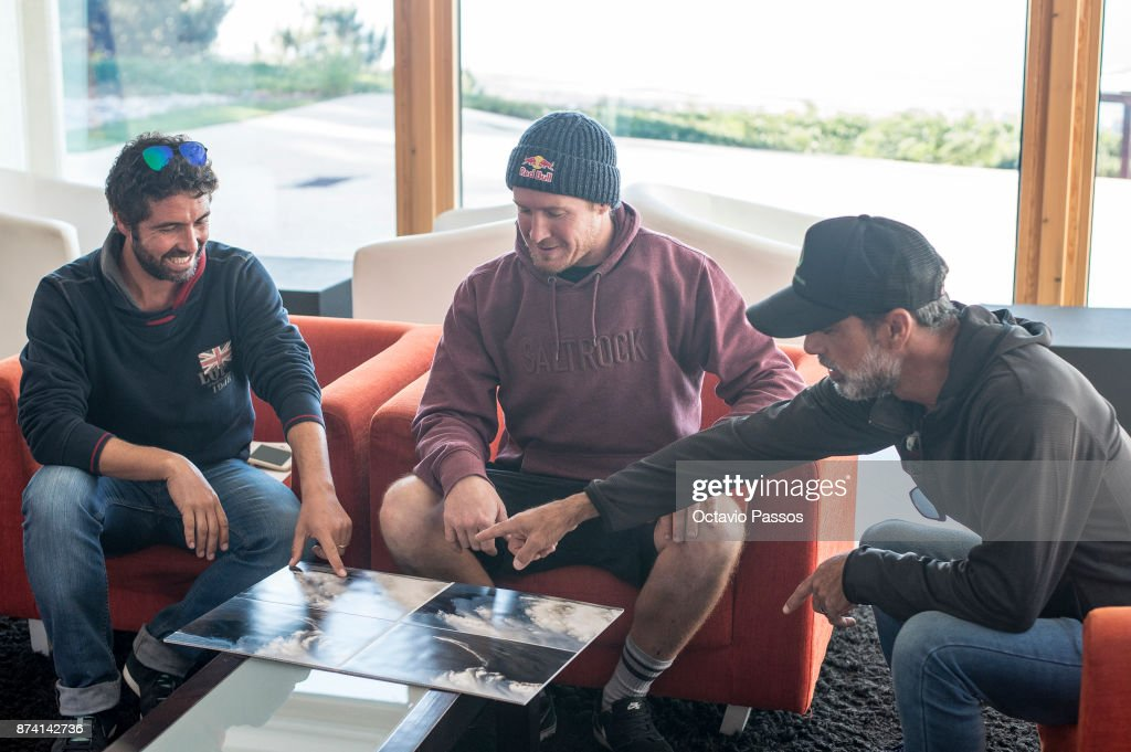 Andrew Cotton (C) and some friends looks for the sequence of images of the wave that he surfed on November 8th at Praia do Norte at Nazare where he suffered his accident, on November 14, 2017 in Nazare, Portugal. Andrew Cotton, 36, from Braunton, Devon in the UK fractured his vertbra L2 after wiping out surfing the giant waves at Nazare Portugal. He was filming a documentary on Wednesday 8th November 2017.