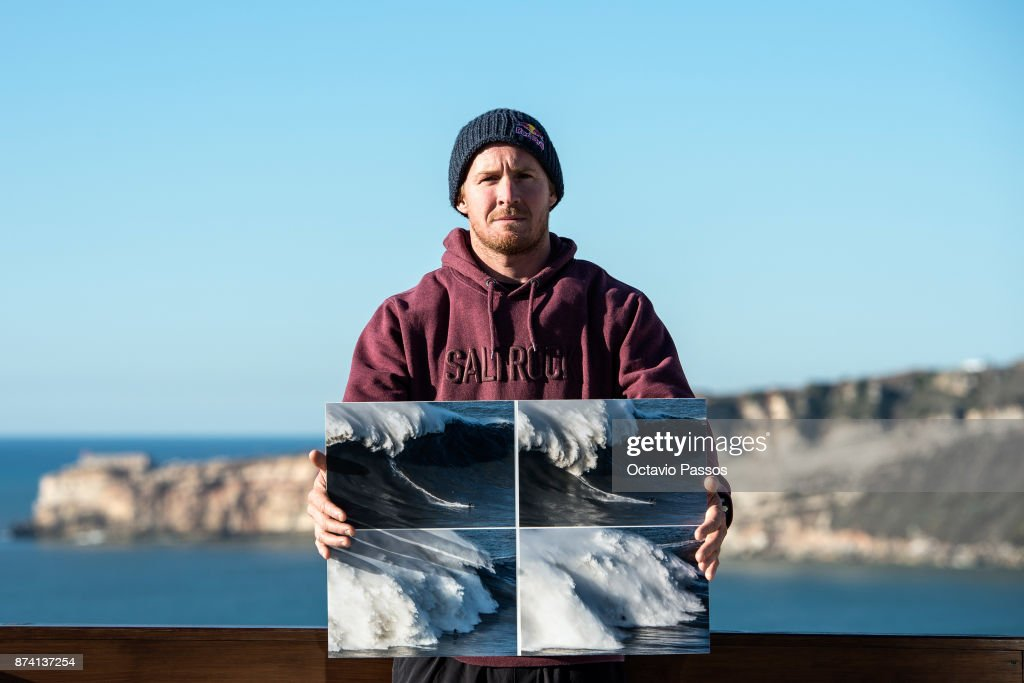 Andrew Cotton poses for a photograph, holding the sequence of images of the wave that he surfed on November 8th at Praia do Norte at Nazare where he suffered his accident, on November 14, 2017 in Nazare, Portugal. Andrew Cotton, 36, from Braunton, Devon in the UK, fractured his vertbra L2 after wiping out surfing the giant waves at Nazare Portugal. He was filming a documentary on Wednesday 8th November 2017.