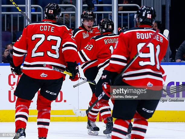 Andrew Coxhead of the Quebec Remparts celebrates with teammates LouisFilip Cote Mikael Robidoux and Matthew Boucher after scoring the game tying goal...