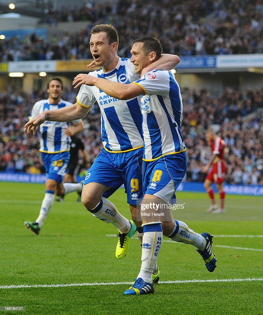 Andrew Crofts of Brighton (R) celebrates after scoring with team mate Ashley Barnes during the Sky Bet Championship match between Brighton & Hove Albion and Nottingham Forest at Amex Stadium on October 5, 2013 in Brighton, England.