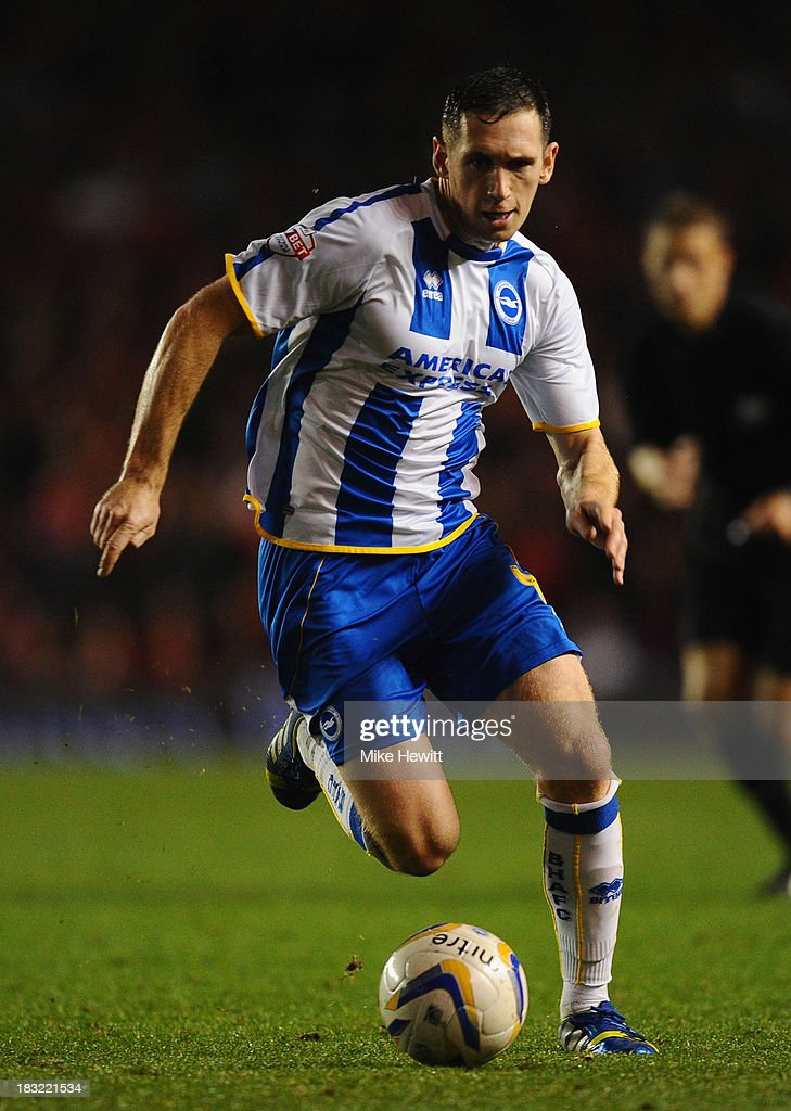 Andrew Crofts of Brighton in action during the Sky Bet Championship match between Brighton & Hove Albion and Nottingham Forest at Amex Stadium on October 5, 2013 in Brighton, England.