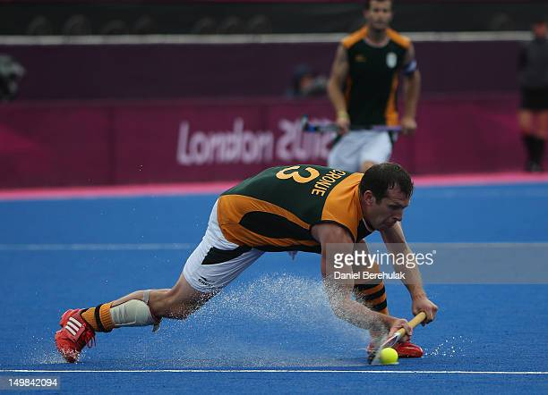 Andrew Cronje of South Africa passes the ball during the Men's Hockey match between Pakistan and South Africa on Day 9 of the London 2012 Olympic...