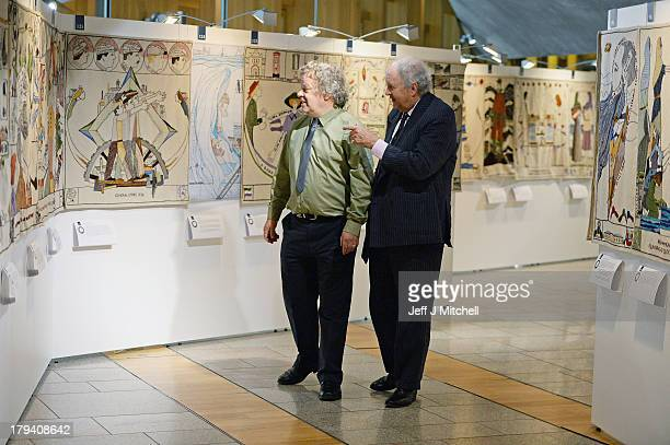 Andrew Crummy and Alexander McCall Smith view the 143 metre long Great Tapestry of Scotland at the Scottish Parliament on September 3 2013 in...