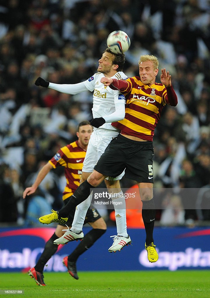 Andrew Davies of Bradford City and Michu of Swansea City go up for a header during the Capital One Cup Final match between Bradford City and Swansea City at Wembley Stadium on February 24, 2013 in London, England.