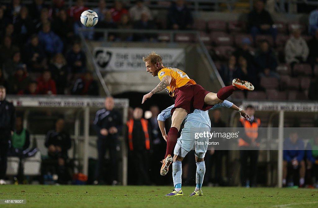 <a gi-track='captionPersonalityLinkClicked' href=/galleries/search?phrase=Andrew+Davies+-+Soccer+Player&family=editorial&specificpeople=4510670 ng-click='$event.stopPropagation()'>Andrew Davies</a> of Bradford City climbs above Nathan Eccleston of Coventry City to head the ball during the Sky Bet League One match between Coventry City and Bradford City at Sixfields Stadium on April 1, 2014 in Northampton, England.