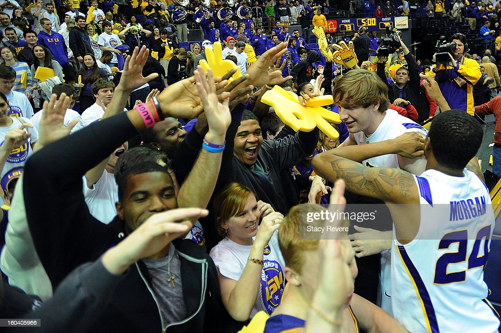 Andrew Del Piero #55 and Malik Morgan #24 of the LSU Tigers celebrate with fans following a victory over the Missouri Tgers at the Pete Maravich Assembly Center on January 30, 2013 in Baton Rouge, Louisiana. LSU won the game 73-70.