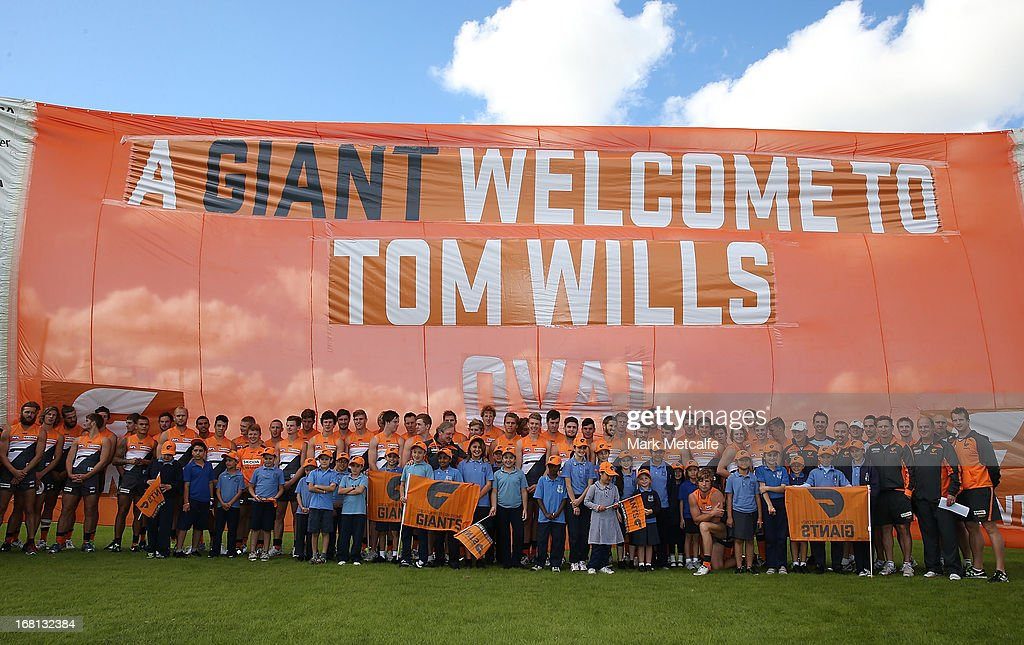 Andrew Demetriou, NSW Minister for Sport Graham Annesley, GWS Giants players and officials and local school children pose during a GWS Giants AFL media session at Sydney Olympic Park Sports Centre on May 6, 2013 in Sydney, Australia.