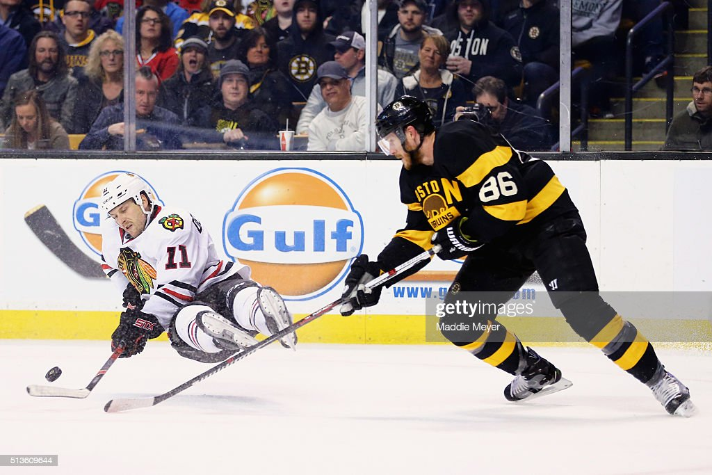 <a gi-track='captionPersonalityLinkClicked' href=/galleries/search?phrase=Andrew+Desjardins&family=editorial&specificpeople=2748431 ng-click='$event.stopPropagation()'>Andrew Desjardins</a> #11 of the Chicago Blackhawks falls while battling for a loose puck against <a gi-track='captionPersonalityLinkClicked' href=/galleries/search?phrase=Kevan+Miller&family=editorial&specificpeople=8236132 ng-click='$event.stopPropagation()'>Kevan Miller</a> #86 of the Boston Bruins during the second period at TD Garden on March 3, 2016 in Boston, Massachusetts.