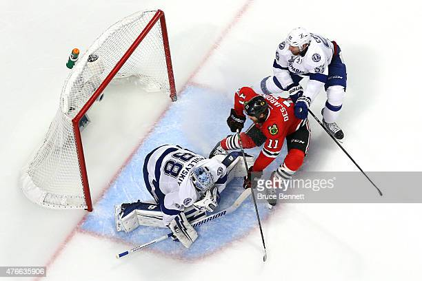 Andrew Desjardins of the Chicago Blackhawks goes to the net against Andrei Vasilevskiy and Braydon Coburn of the Tampa Bay Lightning during Game Four...