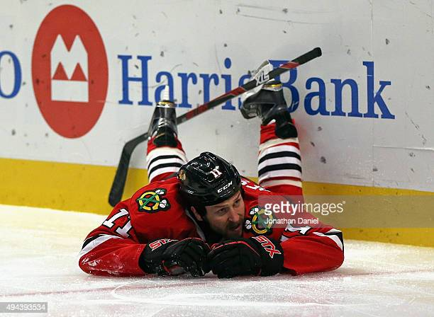 Andrew Desjardins of the Chicago Blackhawks hits the ice skating against the Anaheim Ducks at the United Center on October 26 2015 in Chicago...