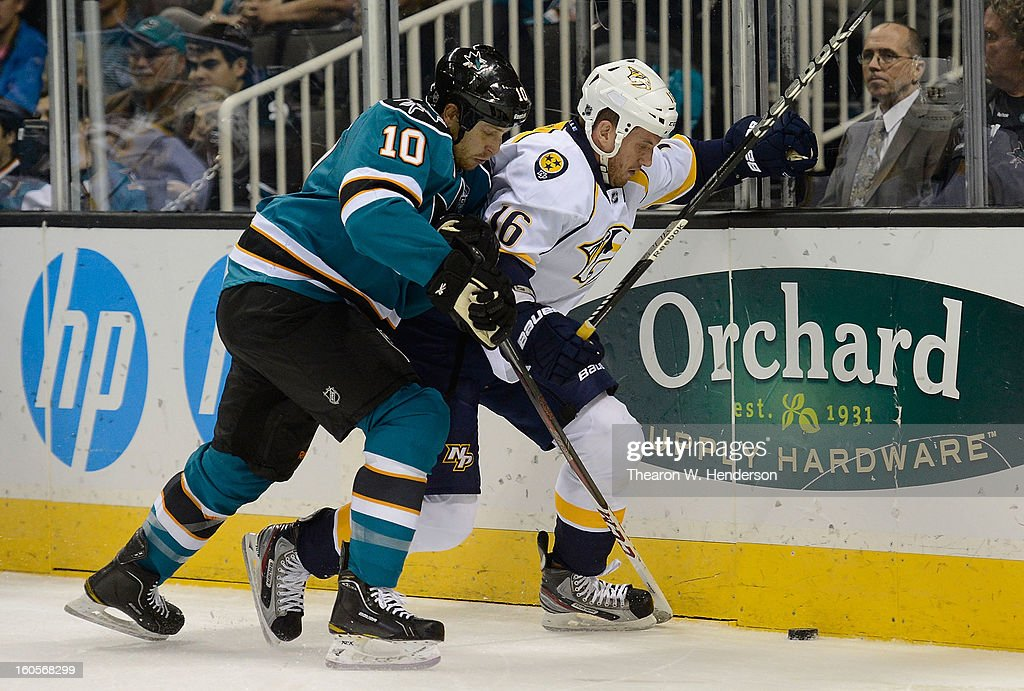 Andrew Desjardins #10 of the San Jose Sharks collides with Rich Clune #16 of the Nashville Predators in the first period of their game at HP Pavilion on February 2, 2013 in San Jose, California.