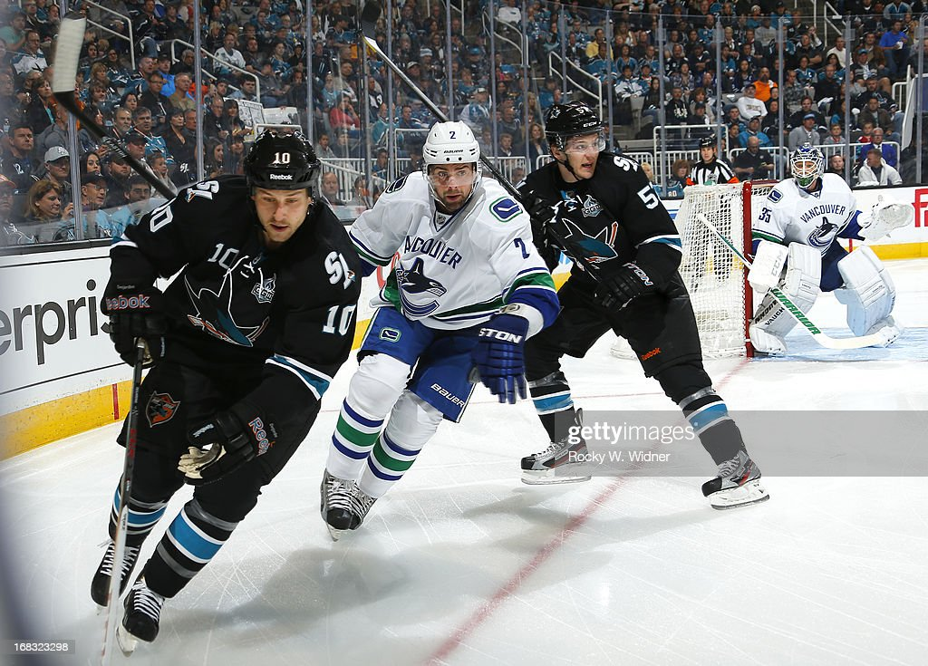 Andrew Desjardins #10 of the San Jose Sharks controls the puck against Dan Hamhuis #2 of the Vancouver Canucks in Game Three of the Western Conference Quarterfinals during the 2013 Stanley Cup Playoffs at HP Pavilion on May 5, 2013 in San Jose, California. The Sharks defeated the Canucks 5-2.