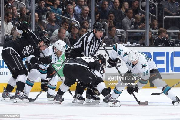 Andrew Desjardins of the San Jose Sharks faces off against Jarret Stoll of the Los Angeles Kings in Game Three of the First Round of the 2014 Stanley...