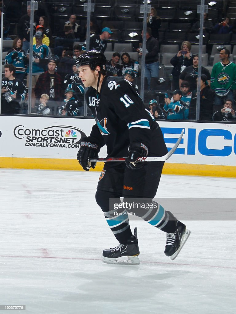 Andrew Desjardins #10 of the San Jose Sharks skates up the ice against the Vancouver Canucks during an NHL game on January 27, 2013 at HP Pavilion in San Jose, California.