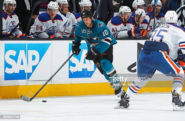 Andrew Desjardins of the San Jose Sharks skates with the puck against the Edmonton Oilers at SAP Center on April 1 2014 in San Jose California