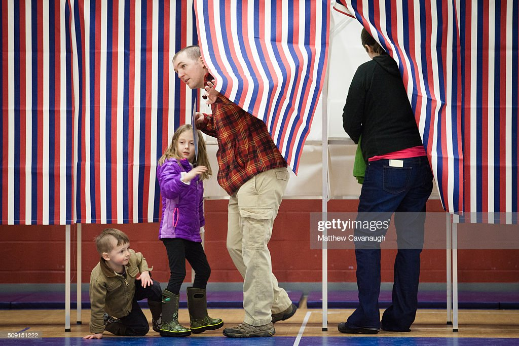 Andrew Desmarais (C) exits a voting booth with his children, 3 year old Simon (L) and 5 year old Lila, on February 9, 2016 at Broken Ground School in Concord, NH. Desmarais' wife Ashley Grover is on the right. Voters throughout the state are heading to the polls as the New Hampshire Primary, also known as the first-in-the-nation primary, continues the process of selecting the next president of the United States.