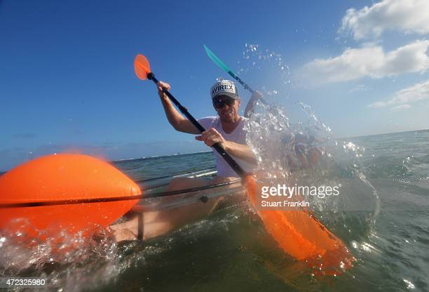 Andrew Dodt of Australia and caddie go kayaking prior to the start of the AfrAsia Bank Mauritius Open at Heritage Golf Club on May 6 2015 in Bel...