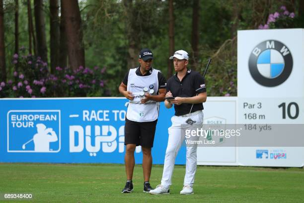 Andrew Dodt of Australia and his caddie look on from the 10th tee during the final round on day four of the BMW PGA Championship at Wentworth on May...