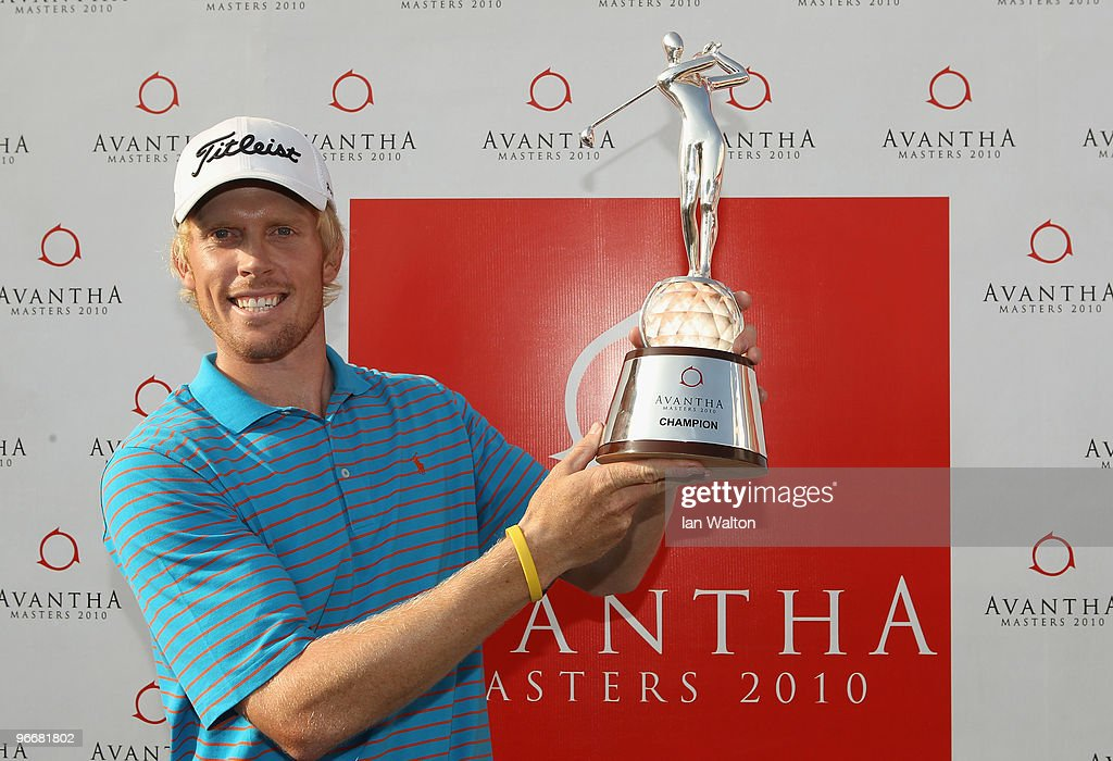 Andrew Dodt of Australia celebrates with the trophy after winning Final Round of the Avantha Masters held at The DLF Golf and Country Club on...