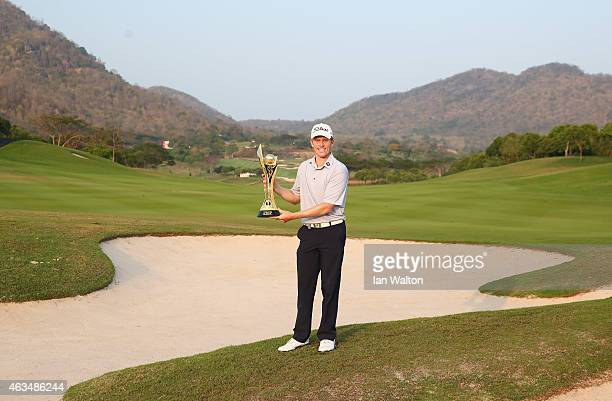 Andrew Dodt of Australia celebrates with the trophy after winning the final round of the 2015 True Thailand Classic at Black Mountain Golf Club on...