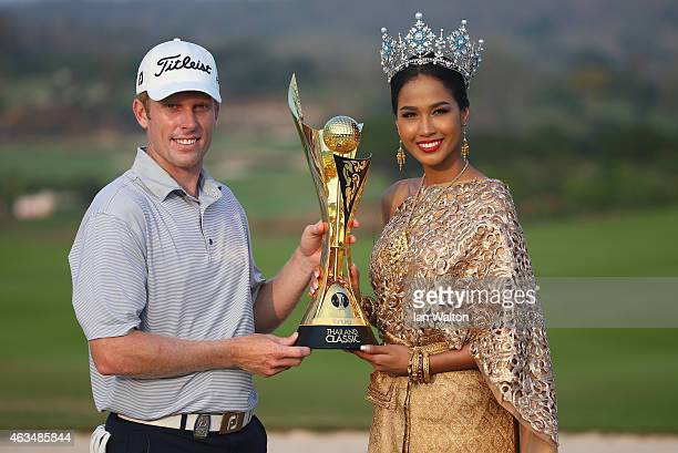 Andrew Dodt of Australia celebrates with the trophy and Nantawan Thongleng miss Thailand after winning the final round of the 2015 True Thailand...