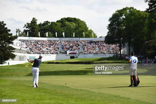 Andrew Dodt of Australia hits an approach shot to the 18th green during day three of the BMW PGA Championship at Wentworth on May 27 2017 in Virginia...